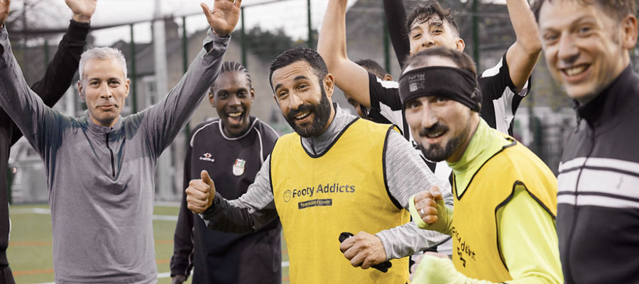 People enjoying football via Footy Addicts games